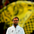 Liverpool's German head coach Jurgen Klopp follows the warm up prior to the UEFA Europe League quarter-final, first-leg football match Borussia Dortmund vs Liverpool FC in Dortmund, western Germany on April 7, 2016. / AFP PHOTO / John MACDOUGALLJOHN MACDOUGALL/AFP/Getty Images