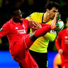 Liverpool's Divock Origi puts his best foot forward against Dortmund's Mat Hummels