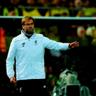 Liverpool's German head coach Jurgen Klopp reacts during the UEFA Europe League quarter-final, first-leg football match Borussia Dortmund vs Liverpool FC in Dortmund, western Germany on April 7, 2016. The match ended with a 1-1 draw. / AFP PHOTO / John MACDOUGALLJOHN MACDOUGALL/AFP/Getty Images