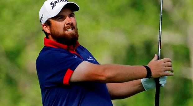 Shane Lowry, of Ireland, watches his tee shot on the 12th hole during the first round of the Masters golf tournament Thursday, April 7, 2016, in Augusta, Ga. (AP Photo/Charlie Riedel)