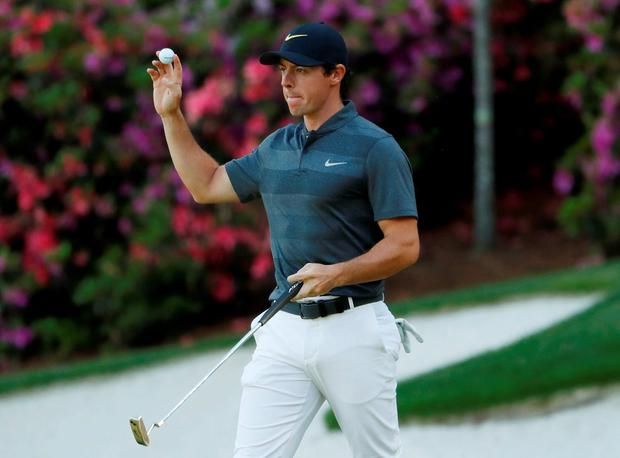 Rory McIlroy waves to the crowd after an eagle putt on the 13th green during the first round of the 2016 The Masters golf tournament at Augusta National Golf Club. Mandatory Credit: Rob Schumacher-USA TODAY Sports