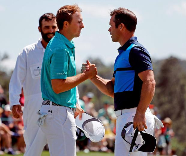 Jordan Spieth, left, shakes hands with Paul Casey, of England, on the 18th hole during the first round of the Masters golf tournament Thursday, April 7, 2016, in Augusta, Ga. (AP Photo/Matt Slocum)