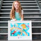 Sightsavers Junior Painter Awards 2016 Overall Winner Laura Gavin (10) from Scoil Bhride, Kilbride Clonee Co Meath with her painting ' We Will All Travel by Motorised Umbrellas. The awards took place in the Science Gallery in Trinity College Dublin. Photo: Leon Farrell/Photocall Ireland.