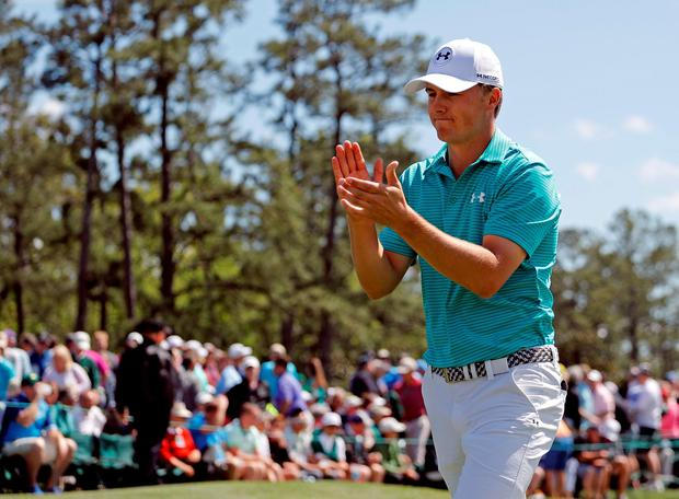 Jordan Spieth applauds on the 18th green following his first round of the Masters golf tournament Thursday, April 7, 2016, in Augusta, Ga. (AP Photo/Matt Slocum)