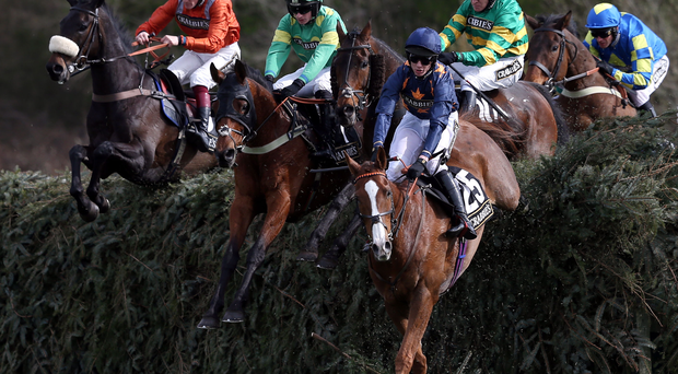 Fairy Rath ridden by jockey Tom Cannon clears a fence followed by eventual winner Eastlake ridden by Barry Geraghty (white helmet) in the Crabbie's Topham Chase during Ladies Day of the Crabbie's Grand National Festival at Aintree Racecourse, Liverpool. PRESS ASSOCIATION Photo. Picture date: Friday April 8, 2016. See PA story RACING Aintree. Photo credit should read: David Davies/PA Wire