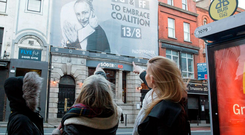 People point to a Paddy Power billboard on the odds for a Fianna Fáil-Fine Gael coalition before the election Photo: Paul Sharp/Sharppix