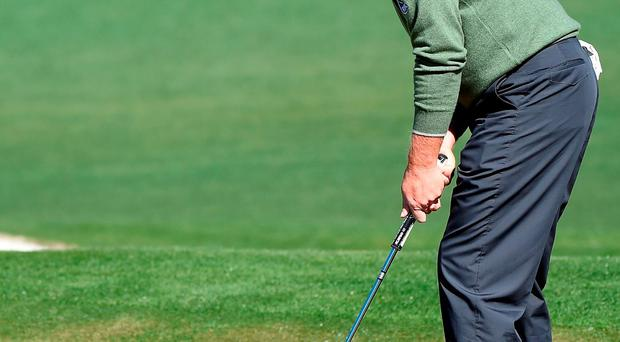 Ernie Els misses a putt on the second hole yesterday (Photo by Harry How/Getty Images)