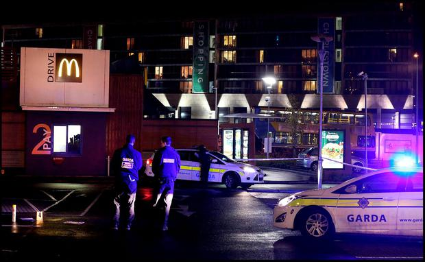 Gardai at the shooting which took place at the KFC and McDonalds Drive in car park near Charlestown Shopping Centre. Pic Steve Humphreys