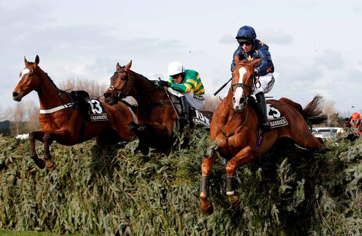 Eastlake, with Barry Geraghty up (centre), jumps the last fence next to Fairy Rath (Tom Cannon) on the way to winning The Topham Chase at Aintree yesterday. Photo: Andrew Yates/Reuters