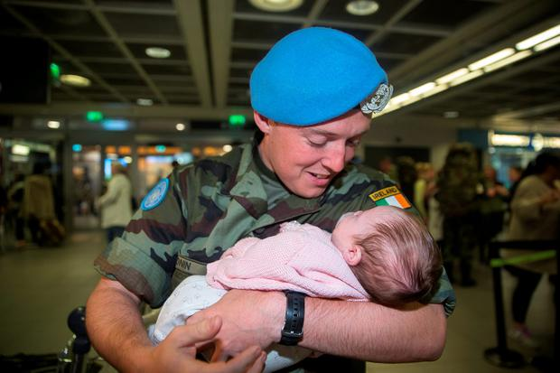 Stephen Cronin, Cobh with his five week old daughter Robyn at Dublin Airport Picture: Arthur Carron