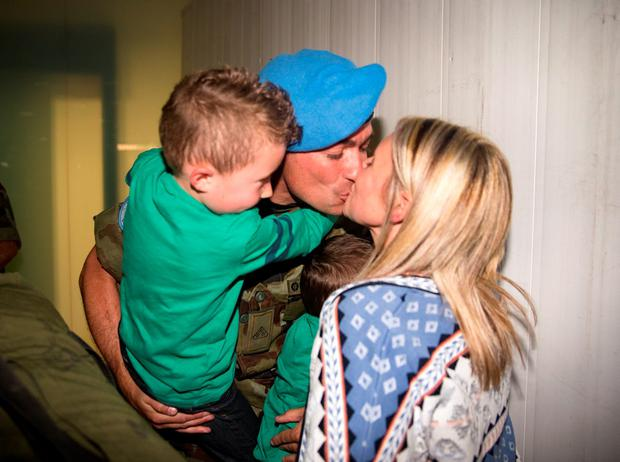 Bernadine O'Mahony with sons Luke and Dara welcome home her husband Robert at Dublin Airport Picture: Arthur Carron