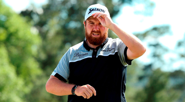 AUGUSTA, GEORGIA - APRIL 08: Shane Lowry of Ireland reacts after putting for bogie on the 18th green during the second round of the 2016 Masters Tournament at Augusta National Golf Club on April 8, 2016 in Augusta, Georgia. (Photo by Andrew Redington/Getty Images)