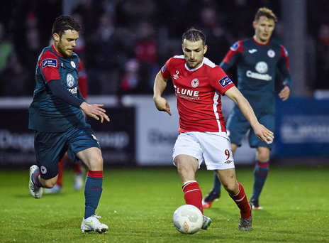 Christy Fagan in action against John Russell (SPORTSFILE)