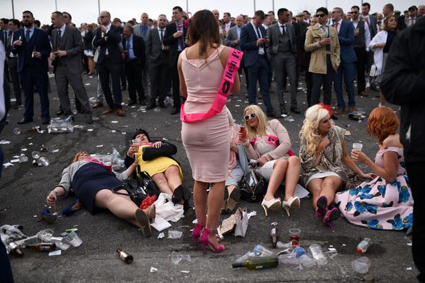 Racegoers attend Ladies Day, the second day of the Grand National Festival horse race meeting at Aintree Racecourse in Liverpool, northern England on April 8, 2016.