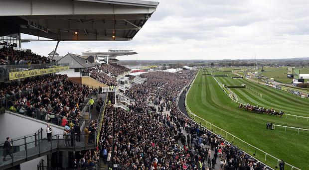 Racegoers watch the first race of the final day of the Grand National Festival horse race meeting at Aintree Racecourse in Liverpool, northern England on April 9, 2016. The annual three day meeting culminates in the Grand National which is run over a distance of four miles and four furlongs (7,242 metres), and is the biggest betting race in the United Kingdom. / AFP / OLI SCARFF (Photo credit should read OLI SCARFF/AFP/Getty Images)