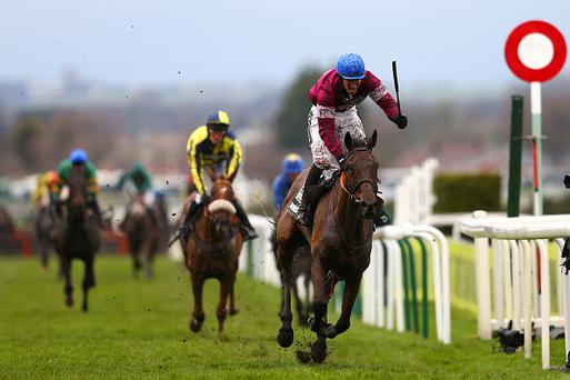LIVERPOOL, ENGLAND - APRIL 09: David Mullins celebrates as he rides Rule The World to victory in the 2016 Crabbie's Grand National at Aintree Racecourse on April 9, 2016 in Liverpool, England. (Photo by Michael Steele/Getty Images)