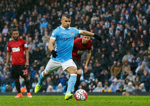 Manchester Citys Argentinian striker Sergio Aguero scores a goal during the English Premier League football match between Manchester City and West Bromwich Albion at the Etihad Stadium in Manchester, north west England, on April 9, 2016. / AFP / LINDSEY PARNABY / RESTRICTED TO EDITORIAL USE. No use with unauthorized audio, video, data, fixture lists, club/league logos or 'live' services. Online in-match use limited to 75 images, no video emulation. No use in betting, games or single club/league/player publications. / (Photo credit should read LINDSEY PARNABY/AFP/Getty Images)