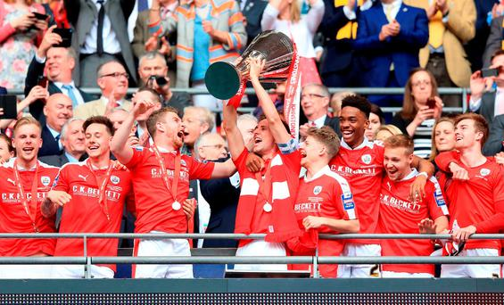 Barnsley's Conor Hourihane lifts the Johnstone's Paint Trophy at Wembley Stadium Photo: PA