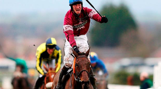David Mullins riding Rule The World celebrates winning the Crabbie's Grand National at Aintree yesterday. Photo: Michael Steele