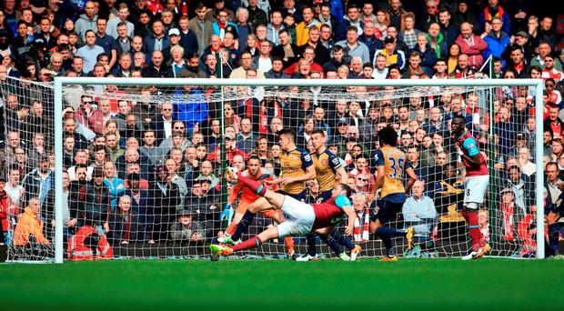 Andy Carroll scores his second goal at Upton Park. Photo: Nick Potts