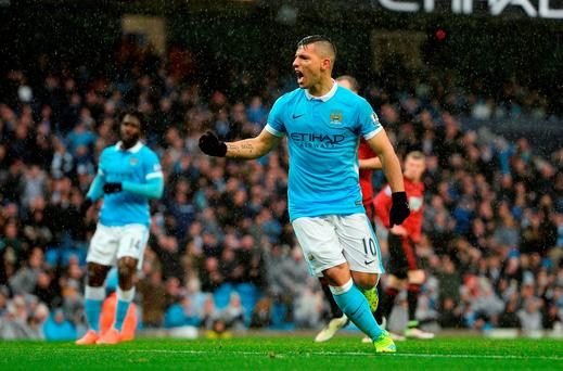 Sergio Aguero of Manchester City celebrates scoring his team's first goal. Photo: Getty
