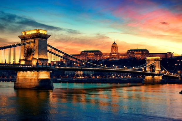 The iconic Danube river that splits the fascinating city of Budapest, overlooked by the imposing Széchenyi Chain Bridge and the Royal Palace