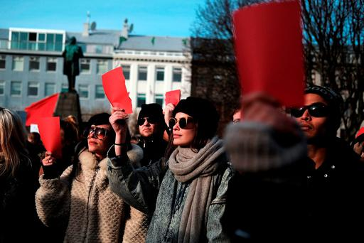 DISCONTENT: Hundreds of protesters holding red cards in Reykjavik after Icelandic prime minister Sigmundur David Gunnlaugsson stepped down over revelations in the Panama Papers. Photo: Spencer Platt/Getty Images