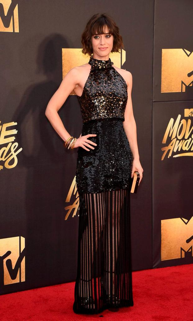 Actress Lizzy Caplan arrives at the 2016 MTV Movie Awards in Burbank, California April 9, 2016. REUTERS/Phil McCarten