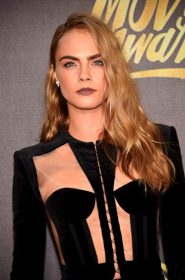 Model Cara Delevingne arrives at the 2016 MTV Movie Awards in Burbank, California April 9, 2016. REUTERS/Phil McCarten