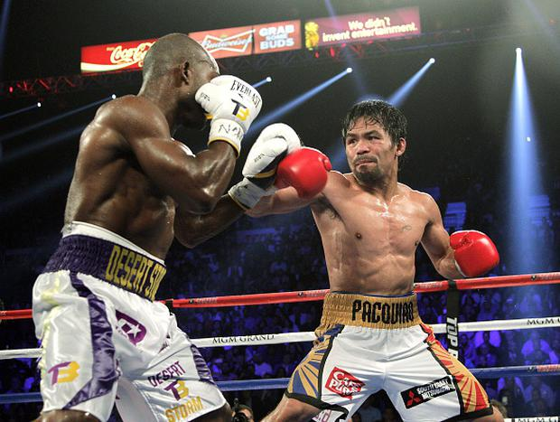 Manny Pacquiao and Timothy Bradley Jr. face off during their WBO International Welterweight title bout at the MGM Grand Arena on April 9, 2016 in Las Vegas, Nevada. Pacquio won a 12 round unanimous decision to capture the WBO International Welterweight Title. / AFP / John GURZINSKI (Photo credit should read JOHN GURZINSKI/AFP/Getty Images)