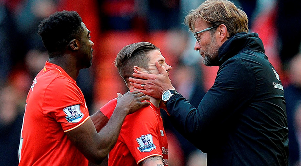 Jurgen Klopp congratulates Liverpool defender Alberto Moreno after his side's 4-1 win over Stoke Getty Images