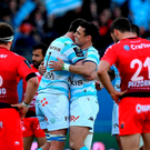Racing Metro 92 South African flanker Bernard Le Roux and Dan Carter eact at the end of their Champions Cup win over Toulon . Getty Images