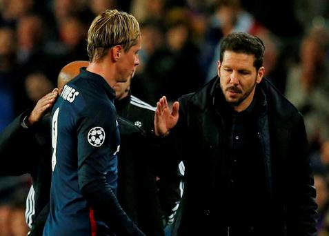 Diego Simeone consoles Fernando Torres after the striker was sent off during Atletico's defeat to Barcelona. Photo: Albert Gea/Reuters