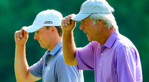 Jordan Spieth and Ben Crenshaw tip their hats to the Augusta crowds last year. Photo: Getty