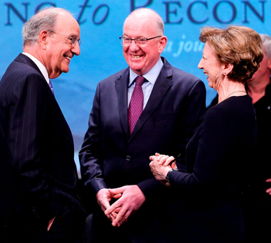 US Senator George Mitchell, Foreign Minister Charlie Flanagan TD and event MC Olivia O'Leary on the Abbey stage Photo: MAXWELLPHOTOGRAPHY.IE