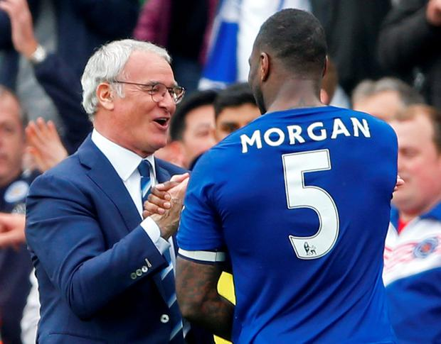 Claudio Ranieri congratulates Wes Morgan after Leicester's victory. Photo: Reuters