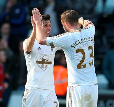 Swansea's Gylfi Sigurdsson celebrates with Jack Cork at the end of the game. Photo: Matthew Childs/Action Images via Reuters