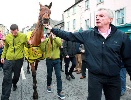 Michael O'Leary leads the Aintree Grand National winner Rule The World through the streets of Mullingar Photo: Frank Mc Grath