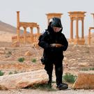 A Russian army sapper works at the historic part of Palmyra, Syria. Photo: Reuters