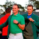 Jordan Spieth presents the Green Jacket to the victorious Danny Willett. Photo: Getty