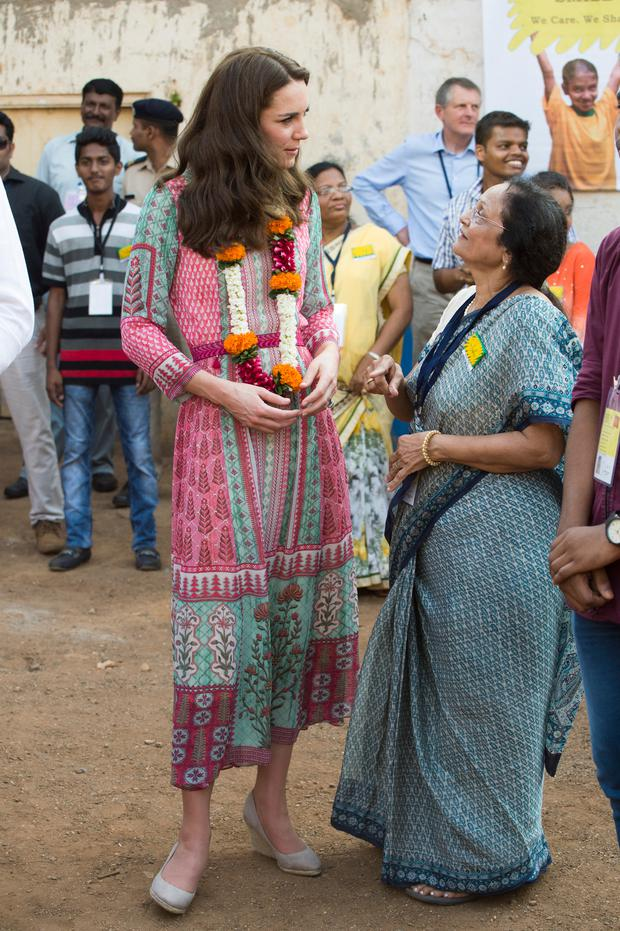 Catherine, Duchess of Cambridgeis given a traditional welcome during a visit to the Banganga Water tank, where they met representatives of SMILE during the royal visit to India and Bhutan on April 10, 2016 in Mumbai, India. (Photo by Arthur Edwards - Pool/Getty Images)