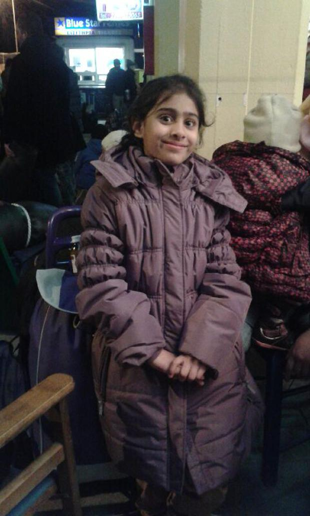 Nuria travelling to Germany with her family, hoping to find a home there Credit: Anne O Rourke - Greek Refugee Crisis