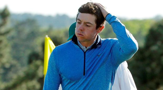 Rory McIlroy walks off the 18th green after after his final round of the Masters golf tournament on Sunday. Photo: Chris Carlson/AP