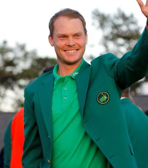 Masters champion Danny Willett waves after winning the Masters golf tournament on Sunday. Photo: Jae C. Hong/AP Photo
