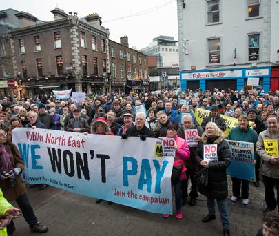 Anti-water charges campaigners taking part in protests outside Irish Water headquarters on Dublin's Talbot Street – similar protests took place in Galway, Cork and Limerick last year. Photo: Tony Gavin