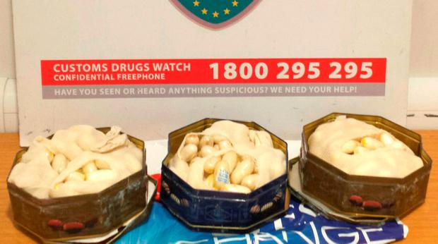 Biscuit tins seized by officers at Dublin Airport. Photo: Revenue Customs Ireland/PA