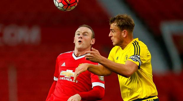 Manchester United's Wayne Rooney battles for the ball with Middlesbrough's Jonny Burn. Photo: Andrew Boyers/Action Images via Reuters