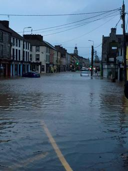 The main street of Midleton in east Cork under waters from a flash flood