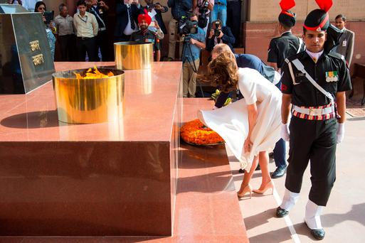 NEW DELHI, INDIA - APRIL 11: Prince William, Duke of Cambridge and Catherine, Duchess of Cambridge lay a wreath to honour the soldiers from Indian regiments who served in World War I at India Gate on April 11, 2016 in New Dehli, India. (Photo by Dominic Lipinski - Pool/Getty Images)