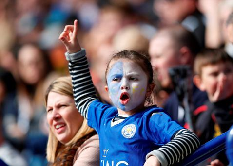 A young Leicester City fan laps up the atmosphere at the King Power Stadium